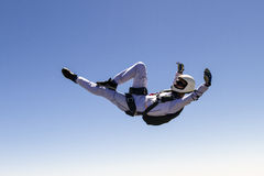 Skydiving photo. A girl performs in a free fall free style royalty free stock photography