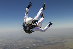 Skydiving photo. A girl performs in a free fall free style stock images
