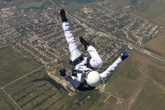 Skydiving photo. A girl performs in a free fall free style royalty free stock photos