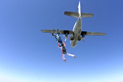 Skydiving photo. The student and instructor jumping from the plane royalty free stock image