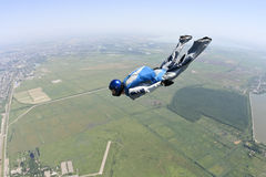 Skydiving photo. Skydiver moves to the horizon royalty free stock images