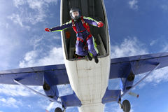 Skydiving photo. The girl parachutist jumps out of an airplane stock image