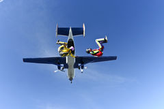 Skydiving photo. Two girls parachutist jumping out of an airplane royalty free stock images