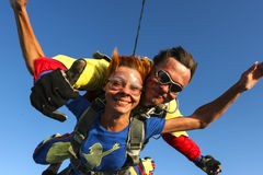Skydiving photo. Tandem. Tandem jump. The girl with the instructor in freefall royalty free stock image