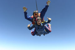 Skydiving photo. Tandem. Tandem jump. Flying in a free fall royalty free stock photography