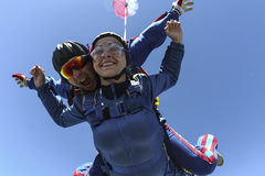 Skydiving photo. Tandem. Tandem jump. Flying in a free fall stock image