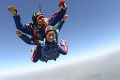 Skydiving photo. Tandem. Tandem jump. Flying in a free fall stock photos