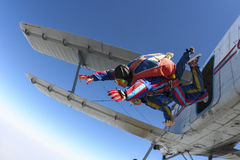 Skydiving photo. Tandem. Tandem jump. Leaving the aircraft royalty free stock images