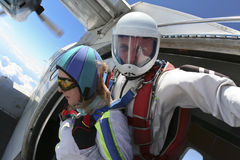 Skydiving photo. Tandem. Tandem jump. Ready for jumping out of an airplane stock photography