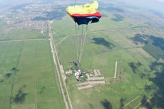 Skydiving photo. Tandem. Tandem jump. The opening of the parachute royalty free stock photos