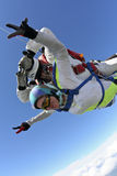 Skydiving photo. Tandem. Tandem jump. The girl with the instructor in freefall royalty free stock photos
