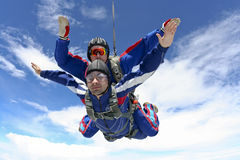 Skydiving photo. Tandem jump. Tandem jump in the sky with clouds royalty free stock photos