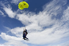 Skydiving photo. Tandem jump. Filling the yellow parachute. Tandem jump stock photo
