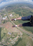 Skydiving point of view of my shoes untied Royalty Free Stock Images
