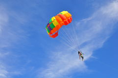 Skydiving. Skydivers parasailing on a parachute in a nice blue sky background Stock Photos
