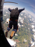 Skydiving student exit from the plane. A student skydiving , AFF mode , jump from the plane. Your instructor is with him Royalty Free Stock Photo