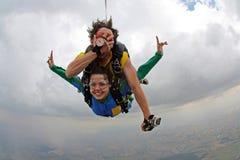 Skydiving tandem funny. Fantastic tandem jump cloudy day Royalty Free Stock Image