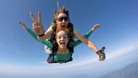 Skydiving tandem happiness. A couple jumping in Brazil Rio de Janeiro Stock Image