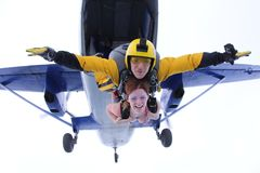 Skydiving. Tandem has just jumped out. stock photos