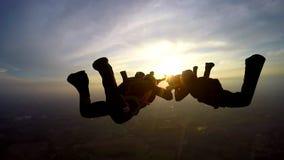 Boituva, São Paulo Brazil on October 6, 2018: A team of 4 professional parachutists jump from parachute stock footage
