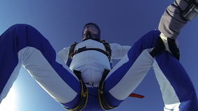 Skydiving video. A group of paratroopers in a free style free fall stock video footage