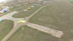 Skydiving video. Parachutists landing on the ground stock video footage