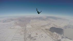 Skydiving video. Sports Skydiver performs figure freestyle stock video footage