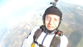 Skydiving video. Sportsman skydiver in free style stock video footage