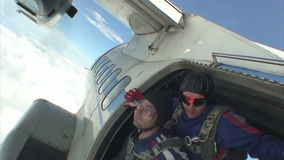 Skydiving video. Tandem jump. Instructor and a passenger in freefall stock video footage