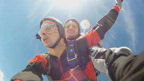 Skydiving video. Tandem jump. A student with an instructor in freefall