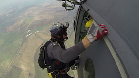 Skydiving video. Two skydiver in freefall in the clouds stock video