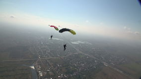 Skydiving video. Two Sports Skydiver piloting his parachute stock video footage