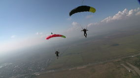 Skydiving video. Two Sports Skydiver piloting his parachute stock video