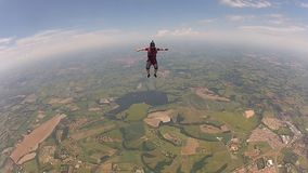 Skydiving woman sit fly. In the skies stock footage