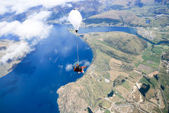 Skydivingsmening in de lucht Stock Foto