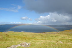 Skye rainbow. Rainbow over the sea near Dunvegan Skye stock images