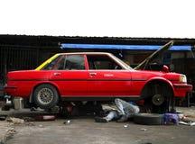skyen för asia taxar bilen isolerade reparationsse Arkivbilder