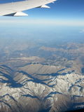Skyfly. Mountains covered partially with snow Stock Photography