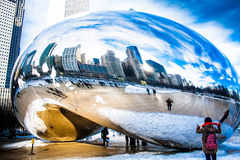 Skygate Bean covering by snow against high building towers and b Royalty Free Stock Image