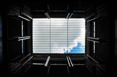 Skylight. A blue cloudy sky. Roof skylight window, beautiful sunlight Stock Photo