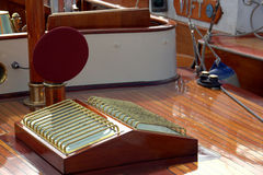Skylight on classic yacht. Closeup of skylight in classic yacht with polished wooden deck Stock Photos