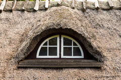 Skylight. Old window in a thatched roof Royalty Free Stock Photos