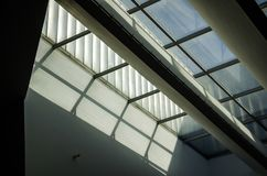 Skylight and shadow. The sun shone through the glass doors and windows, and shadows fell on the ground Royalty Free Stock Image