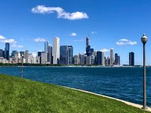 Skyline From Adler Planetarium. This is a Summer picture of the iconic Chicago skyline from Adler Planetarium located in Chicago, Illinois in Cook County.  This royalty free stock images