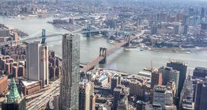 Skyline aerial view of New York City with a view of the Brooklyn and Manhattan Bridges and East River. stock photos