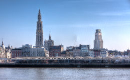 Skyline of Antwerp, Belgium, under a blue sky. Skyline of the Belgian city of Antwerp with houses, office buildings, churches and the Cathedral on a sunny day Royalty Free Stock Image