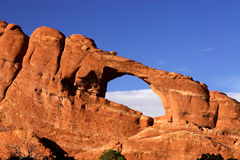 Skyline Arch. In Arches National Park Utah silhouetted against blue sky Stock Photo