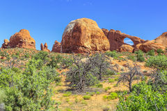 Skyline Arch, Arches National Park, Utah. View of Skyline Arch and other otherworldly rock formations in Arches National Park, Utah Stock Photography