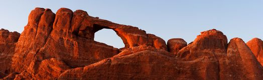 Skyline Arch Sunset, close-up (stitched panorama). Skyline Arch - one of 2,000 documented in Arches National Park - basking in the sunset glow royalty free stock images