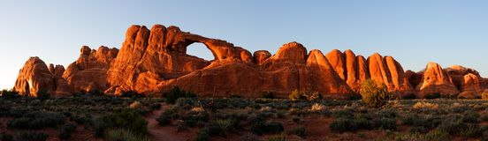 Skyline Arch at Sunset - stitched panrama. Skyline Arch - one of 2000 catalogued in Arches National Park - basks in the evening glow of sunset.  Utah state, USA Stock Photo